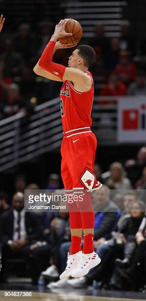 Zach LaVine of the Chicago Bulls hits his first shot as a member of the Bulls a three pointer against the Detroit Pistons at the United Center on...