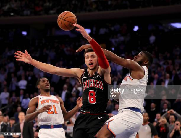 Zach LaVine of the Chicago Bulls is fouled by Emmanuel Mudiay of the New York Knicks in the final seconds of the second overtime period at Madison...