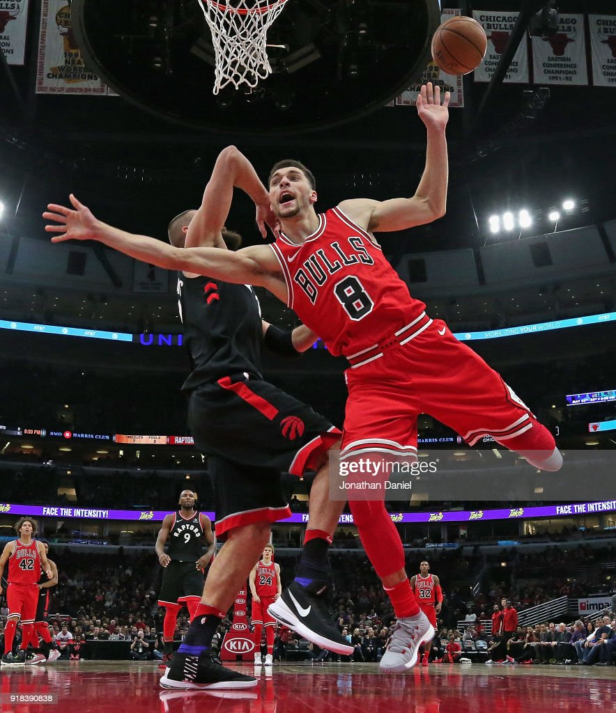 Zach LaVine #8 of the Chicago Bulls Looses control of the ball after being fouled by Jonas Valanciunas #17 of the Toronto Raptors at the United Center on February 14, 2018 in Chicago, Illinois. The Raptors defeated the Bulls 122-98.