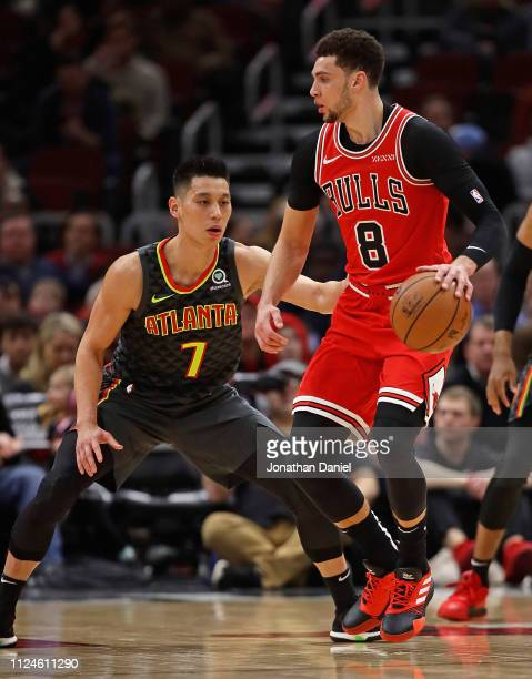 Zach LaVine of the Chicago Bulls moves against Jeremy Lin of the Atlanta Hawks at the United Center on January 23 2019 in Chicago Illinois NOTE TO...