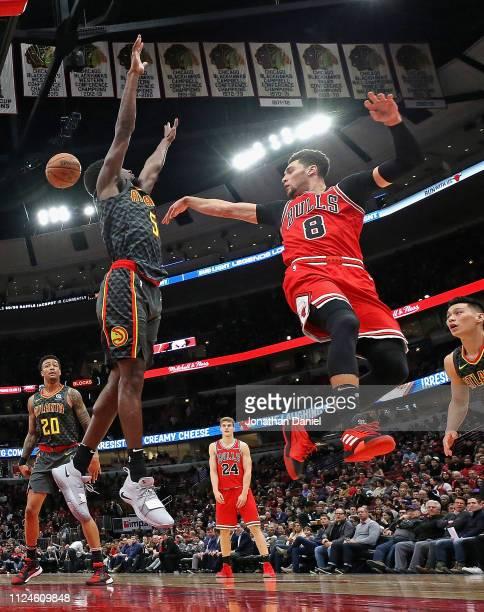 Zach LaVine of the Chicago Bulls passes over Daniel Hamilton of the Atlanta Hawks at the United Center on January 23 2019 in Chicago Illinois The...