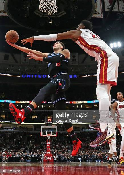 Zach LaVine of the Chicago Bulls puts up a shot against Hassan Whiteside of the Miami Heat at the United Center on November 23 2018 in Chicago...