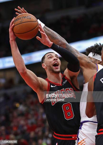 Zach LaVine of the Chicago Bulls puts up a shot against Kelly Oubre Jr #3 of the Phoenix Suns at the United Center on February 22 2020 in Chicago...