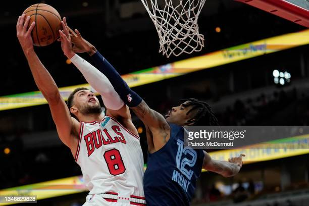 Zach LaVine of the Chicago Bulls shoots the ball against Ja Morant of the Memphis Grizzlies in the first half during a preseason game at United...