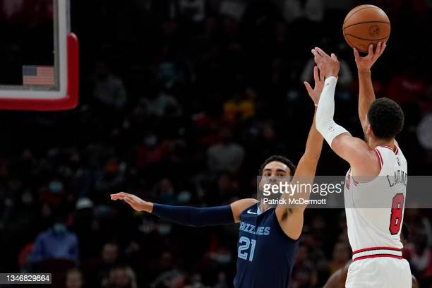 Zach LaVine of the Chicago Bulls shoots the ball against Tyus Jones of the Memphis Grizzlies in the second half during a preseason game at United...