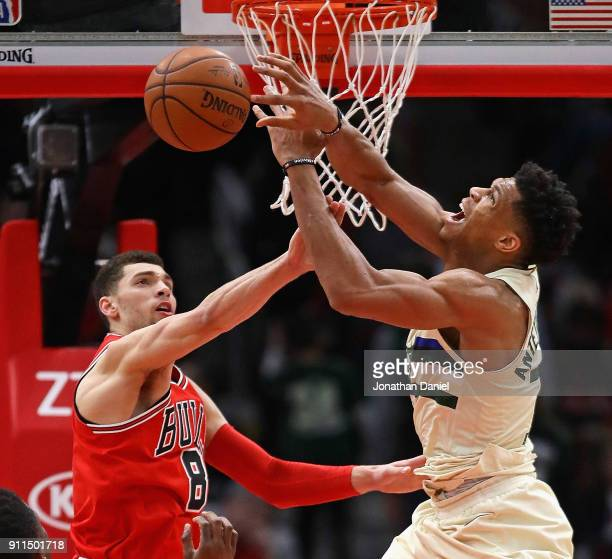 Zach LaVine of the Chicago Bullsfouls Giannis Antetokounmpo of the Milwaukee Bucks at the United Center on January 28 2018 in Chicago Illinois The...