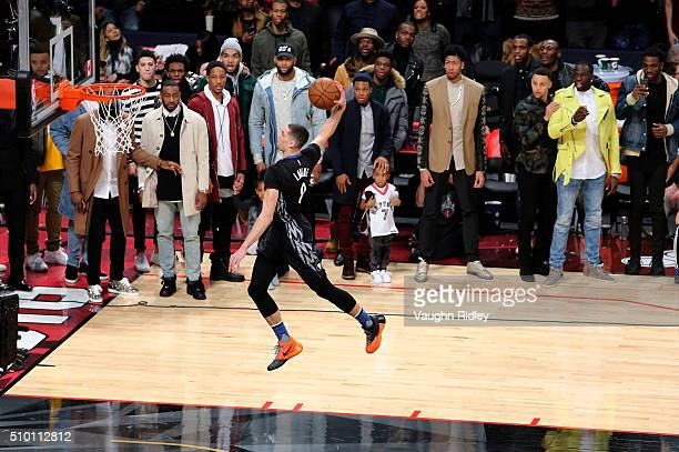 Zach LaVine of the Minnesota Timberwolves dunks as NBA players look on in the Verizon Slam Dunk Contest during NBA AllStar Weekend 2016 at Air Canada...