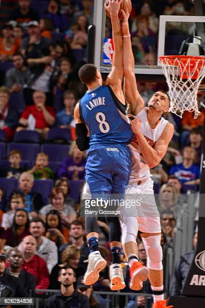 Zach LaVine of the Minnesota Timberwolves dunks the ball over Alex Len of the Phoenix Suns on November 25 2016 at Talking Stick Resort Arena in...