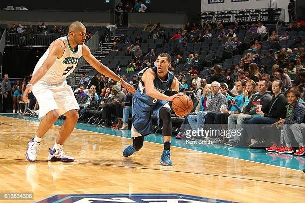 Zach LaVine of the Minnesota Timberwolves handles the ball against Nicolas Batum of the Charlotte Hornets during a preseason game on October 10 2016...