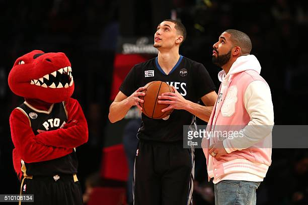 Zach LaVine of the Minnesota Timberwolves looks on with rapper Drake in the Verizon Slam Dunk Contest during NBA AllStar Weekend 2016 at Air Canada...