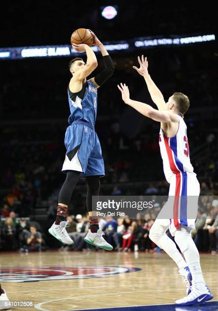 Zach laVine of the Minnesota Timberwolves shoots overJon Leuer of the Detroit Pistons in the first half at the Palace of Auburn Hills on February 3...