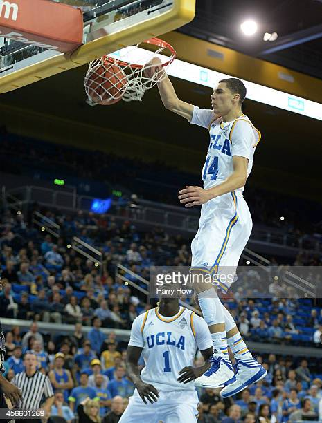 Zach LaVine of the UCLA Bruins dunks in front of Wanaah Bail during a 9571 win over the Prairie View AM Panthers at Pauley Pavilion on December 14...