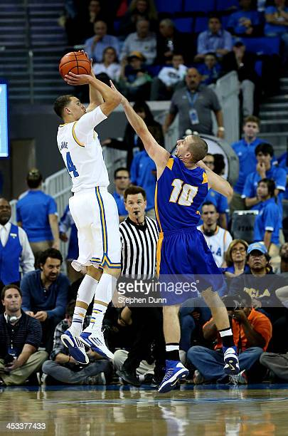 Zach LaVine of the UCLA Bruins shoots over Kyle Bswell of the UCSB Gauchos at Pauley Pavilion on December 3 2013 in Los Angeles California