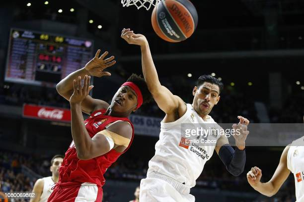 Zach Leday #32 of Olympiacos Piraeus competes with Gustavo Ayon #14 of Real Madrid during the 2018/2019 Turkish Airlines EuroLeague Regular Season...