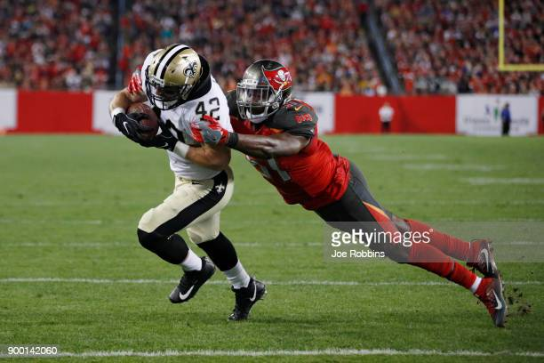 Zach Line of the New Orleans Saints makes a threeyard touchdown reception ahead of Kendell Beckwith of the Tampa Bay Buccaneers in the fourth quarter...