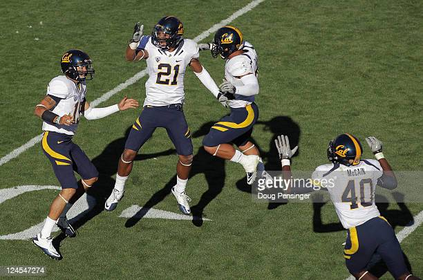 Zach Maynard Keenan Allen Isi Sofele and Chris McCain of the California Golden Bears celebrate their 3633 overtime victory over the Colorado...