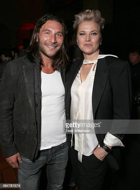 Zach McGowan and Lucy Lawless attend the after party for the Premiere Of STARZ's 'Ash vs Evil Dead' at Teddy's on October 28 2015 in Hollywood...