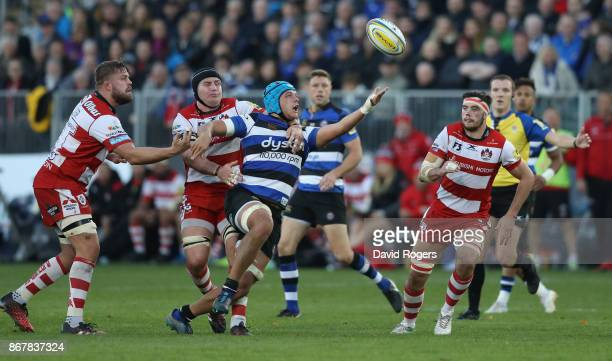 Zach Mercer of Bath attempts to gather the loose ball as Ben Morgan challenges during the Aviva Premiership match between Bath Rugby and Gloucester...