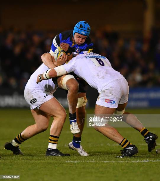 Zach Mercer of Bath is tackled by Jake CooperWoolley and James Haskell of Wasps during the Aviva Premiership match between Bath Rugby and Wasps at...