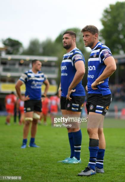 Zach Mercer of Bath Rugby, Elliott Stooke of Bath Rugby and Rhys Priestland of Bath Rugby cut dejected figures at the end of the match during the...