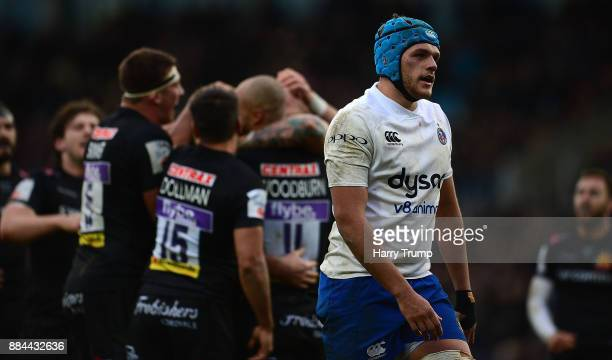 Zach Mercer of Bath Rugby reacts as Thomas Waldrom of Exeter Chiefs celebrates his sides fifth try during the Aviva Premiership match between Exeter...
