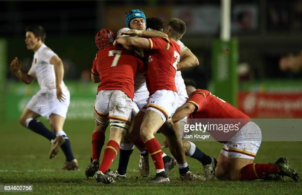 Zach Mercer of England is tackled by Will Jones of Wales during the U20 Six Nations match between Wales U20 and England U20 at Eirias Stadium on...