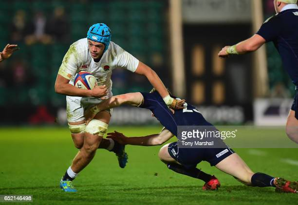 Zach Mercer of England U20 is tackled by Craig Pringle of Scotland U20 during the Under 20s Six Nations Rugby match between England U20 and Scotland...