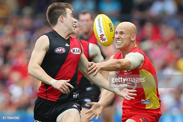 Zach Merrett of the Bombers and Gary Ablett of the Suns compete for the ball during the round one AFL match between the Gold Coast Suns and the...