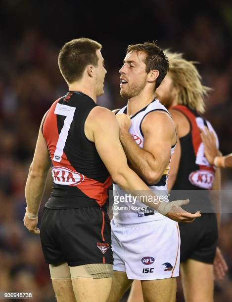 Zach Merrett of the Bombers and Richard Douglas of the Crows push each other during the round one AFL match between the Essendon Bombers and the...