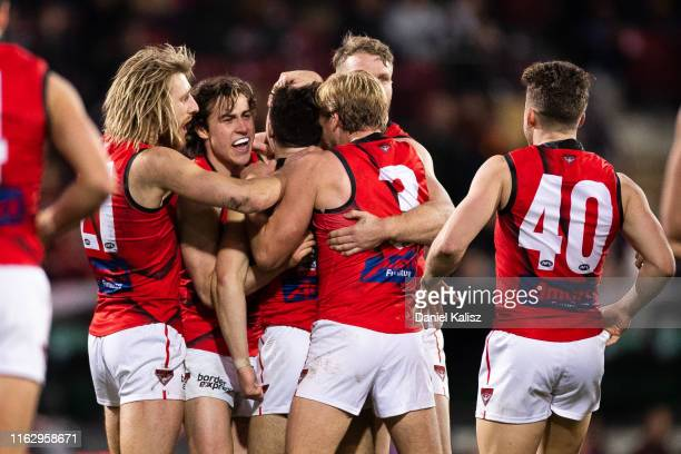 Zach Merrett of the Bombers celebrates with his team mates after kicking a goal during the round 18 AFL match between the Adelaide Crows and the...