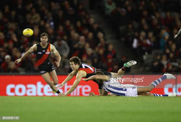 Zach Merrett of the Bombers gets rid of the ball during the round 18 AFL match between the Essendon Bombers and the North Melbourne Kangaroos at...
