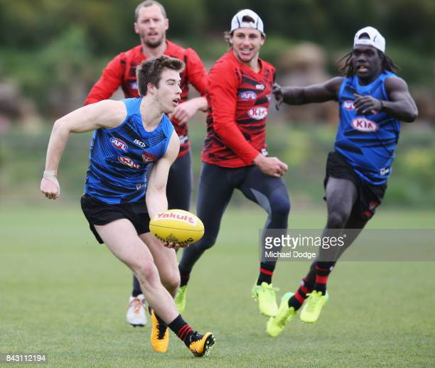 Zach Merrett of the Bombers handballs during an Essendon Bombers AFL training session at the Essendon Football Club on September 6 2017 in Melbourne...