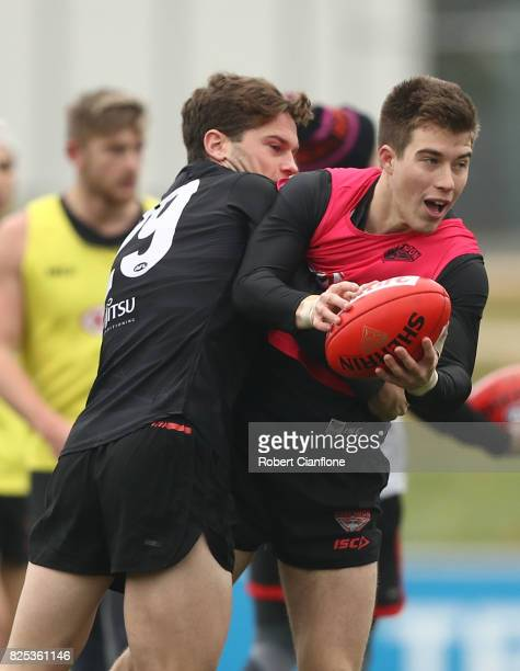 Zach Merrett of the Bombers is challenged by Patrick Ambrose during an Essendon Bombers AFL training session at the Essendon Bombers Club on August 2...