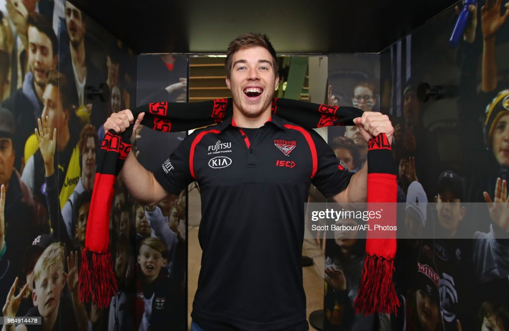 Zach Merrett of the Bombers poses inside of the the Scream-a-Meter during the Simply Energy AFL and Etihad Stadium Announcement at Etihad Stadium on June 26, 2018.