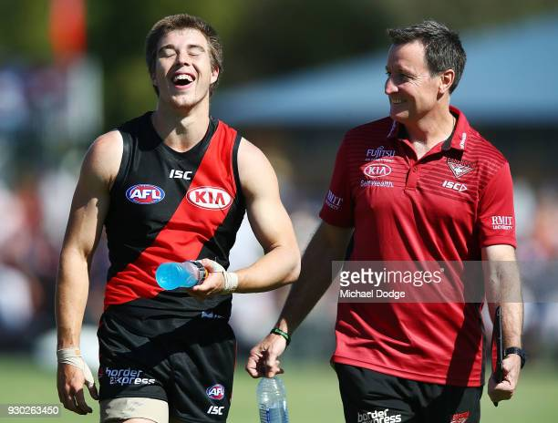 Zach Merrett of the Bombers reacts with Bombers head coach John Worsfold after the win during the JLT Community Series AFL match between the Geelong...