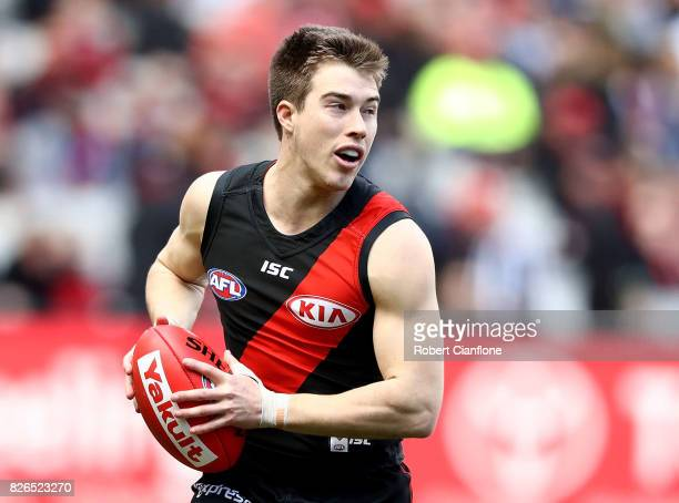 Zach Merrett of the Bombers runs with the ball during the round 20 AFL match between the Essendon Bombers and the Carlton Blues at Melbourne Cricket...