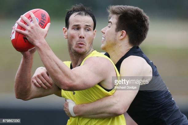 Zach Merrett tackles Matt Dea during an Essendon Bombers AFL training session at the Essendon Bombers Football Club on November 27 2017 in Melbourne...