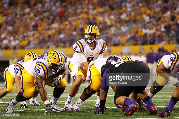 Zach Mettenberger of the LSU Tigers looks on during a game against the TCU Horned Frogs at Cowboys Stadium on August 31 2013 in Arlington Texas