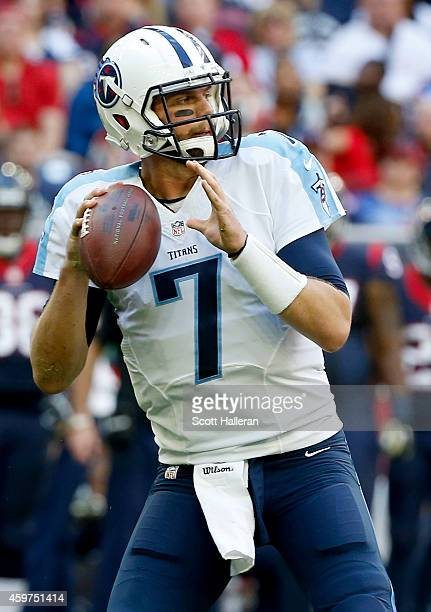 Zach Mettenberger of the Tennessee Titans drops back in the pocket against the Houston Texans in the first quarter in a NFL game on November 30 2014...