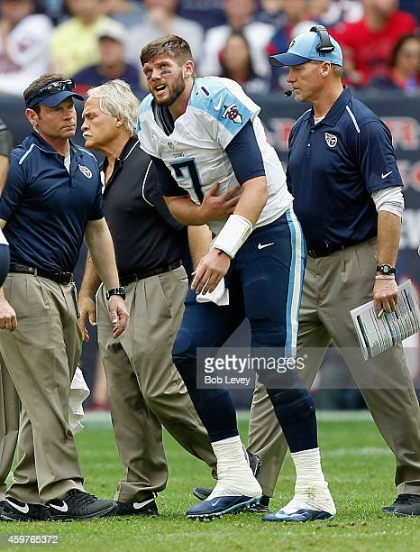 Zach Mettenberger of the Tennessee Titans is helped off the field after he took a hard hit from JJ Watt of the Houston Texans at NRG Stadium on...
