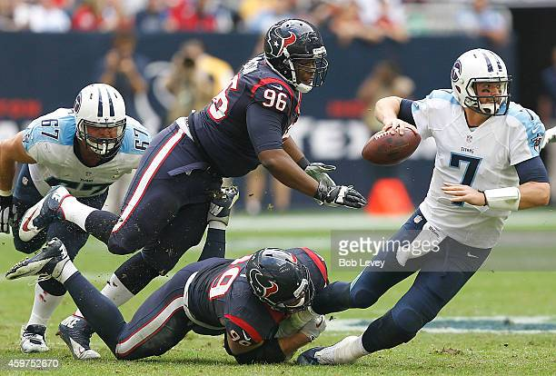 Zach Mettenberger of the Tennessee Titans is sacked by JJ Watt of the Houston Texans in the second quarter in a NFL game on November 30 2014 at NRG...