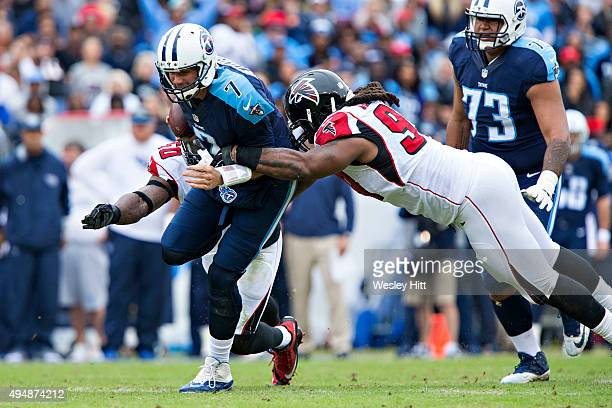 Zach Mettenberger of the Tennessee Titans is tackled by Adrian Clayborn of the Atlanta Falcons at Nissan Stadium on October 25, 2015 in Nashville,...
