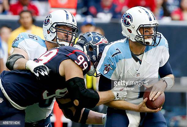 Zach Mettenberger of the Tennessee Titans is tackled by JJ Watt of the Houston Texans in the first quarter in a NFL game on November 30 2014 at NRG...