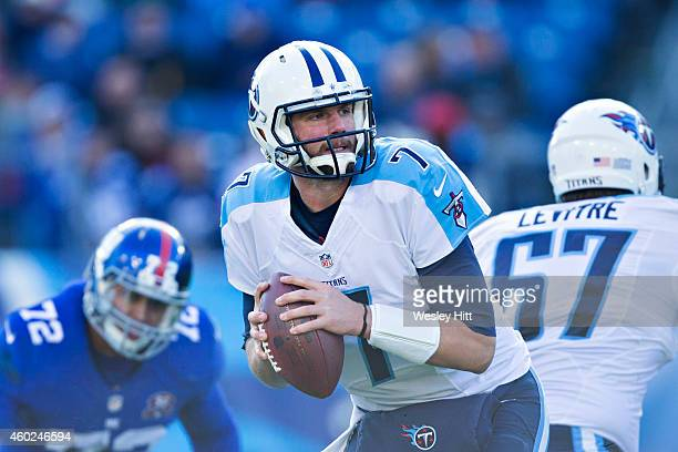 Zach Mettenberger of the Tennessee Titans looks to make a pass during a game against the New York Giants at LP Field on December 7 2014 in Nashville...