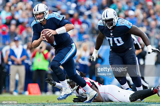 Zach Mettenberger of the Tennessee Titans runs the ball during a game against the Atlanta Falcons at Nissan Stadium on October 25 2015 in Nashville...