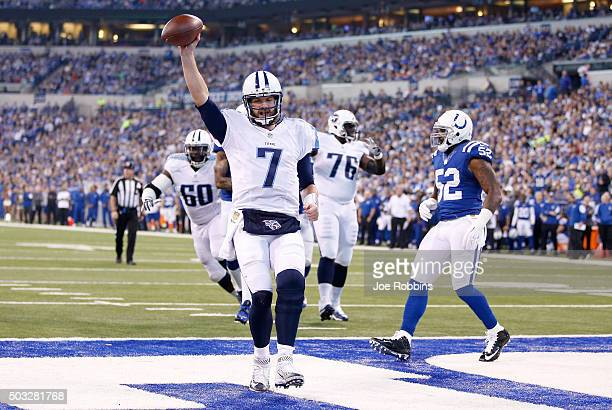 Zach Mettenberger of the Tennessee Titans scores a touchdown against the Indianapolis Colts at Lucas Oil Stadium on January 3 2016 in Indianapolis...