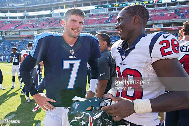 Zach Mettenberger of the Tennessee Titans talks with Alfred Blue of the Houston Texans after the game at LP Field on October 26 2014 in Nashville...