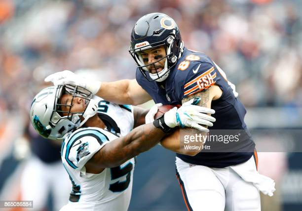 Zach Miller of the Chicago Bears carries the football against Shaq Thompson of the Carolina Panthers in the first quarter at Soldier Field on October...