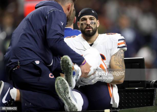 Zach Miller of the Chicago Bears is carted off the field after sustaining an injury during the third quarter against the New Orleans Saints at the...