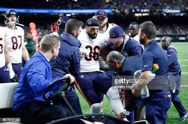 Zach Miller of the Chicago Bears is helped off the field after sustaining an injury during the third quarter against the New Orleans Saints at the...